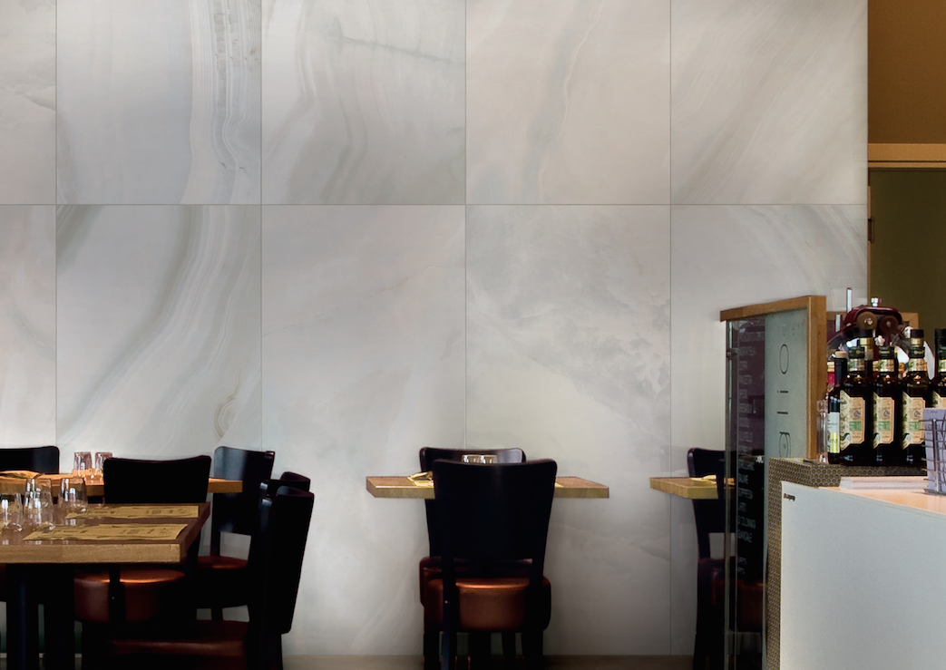 Pearl floor & wall tile evoke slices of luminous alabaster stone